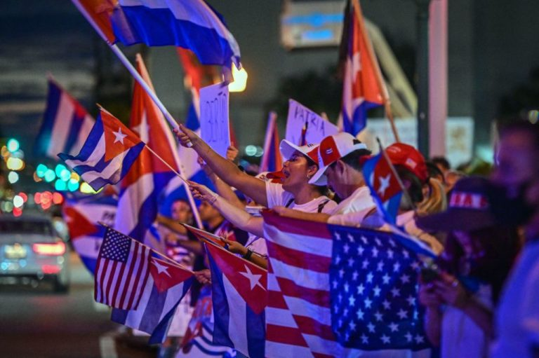 People hold Cuban and U.S. national flags as they gather to show their support for Cubans demonstrating against the Communist Party of Cuba in front of Versailles restaurant in the Little Havana neighborhood in Miami, Florida, on July 26, 2021. The CCP's People's Armed Police anti-dissent paramilitary force, which was deployed to help crush Hong Kong's 2019 anti-communism protests, has been training the Cuban Black Berets special forces since at least 2008.