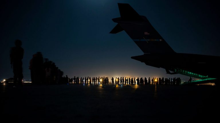In this handout provided by the U.S. Air Force, an air crew prepares to load evacuees aboard a C-17 Globemaster III aircraft in support of the Afghanistan evacuation at Hamid Karzai International Airport on August 21, 2021 in Kabul, Afghanistan.