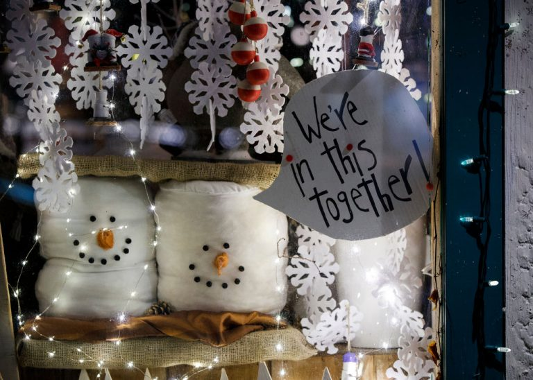 """A window display sign reads """"We're in this together!"""" is seen at a storefront on December 18, 2020 in Richmond, British Columbia, Canada. Provincial health officer Dr. Bonnie Henry spammed 100,000 citizens with a vaccine acceptance mail-out that revealed their vaccination status for all eyes to see."""