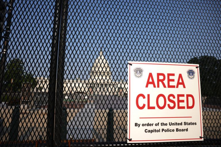The U.S. Capitol is seen behind security fencing on July 6, 2021 in Washington, D.C. Several current and former anonymous FBI agents told Reuters in an August 20 article that there is no evidence the Jan. 6 Capitol Building riots were an organized insurrection.