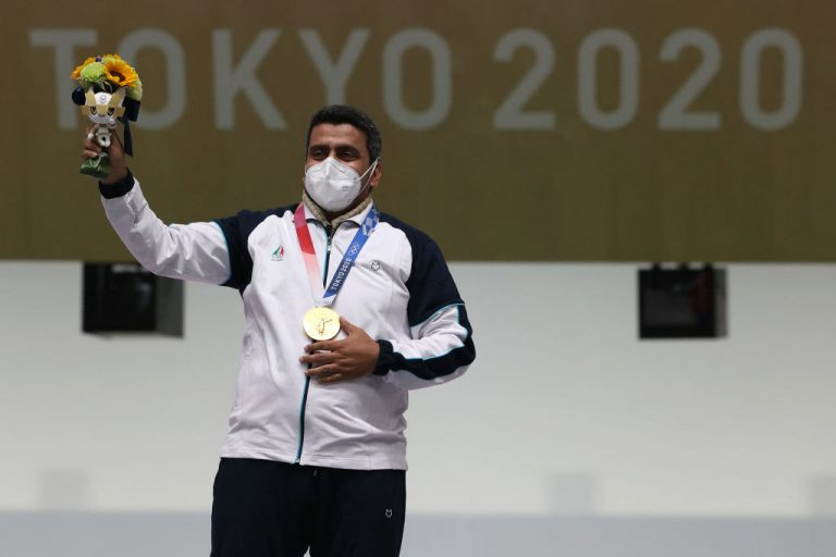 Gold Medalist Javad Foroughi of Team Iran poses on the podium following the 10m Air Pistol Men's event on day one of the Tokyo 2020 Olympic Games at Asaka Shooting Range on July 24, 2021 in Asaka, Saitama, Japan.
