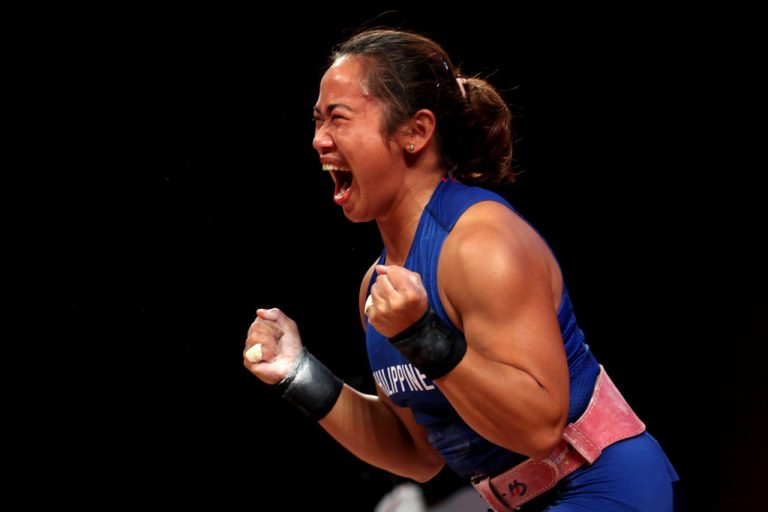 Hidilyn Diaz of Team Philippines competes during the Women's 55kg Weightlifting Group in Tokyo, Japan.