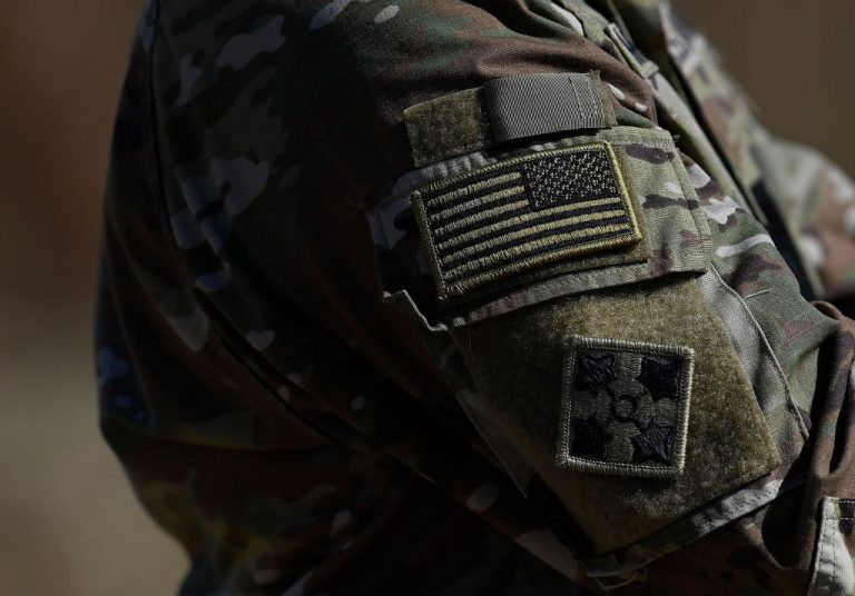 The U.S Army insignia can be seen worn during a paratrooper drop as part of exercise 'Talisman Sabre 21' on July 28, 2021 in Charters Towers, Australia. Secretary of Defense Lloyd Austin says COVID-19 vaccination will become mandatory for all personnel no later than Sept. 15, but may come earlier depending on when the FDA rushes full approval of the injections..