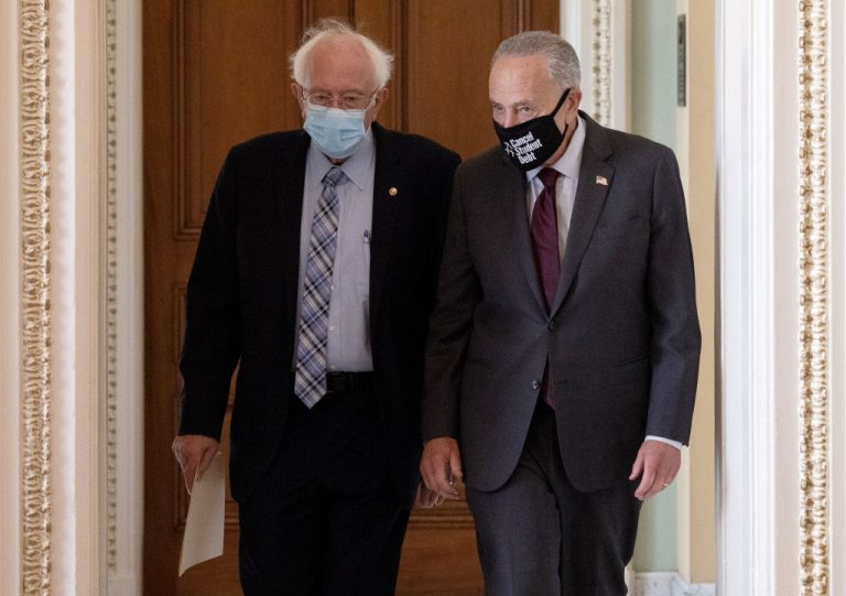 Sen. Bernie Sanders (L) (I-VT) walks with Senate Majority Leader Chuck Schumer (D-NY) after meeting on pending budget resolution legislation in Schumer's office August 09, 2021 in Washington, DC.