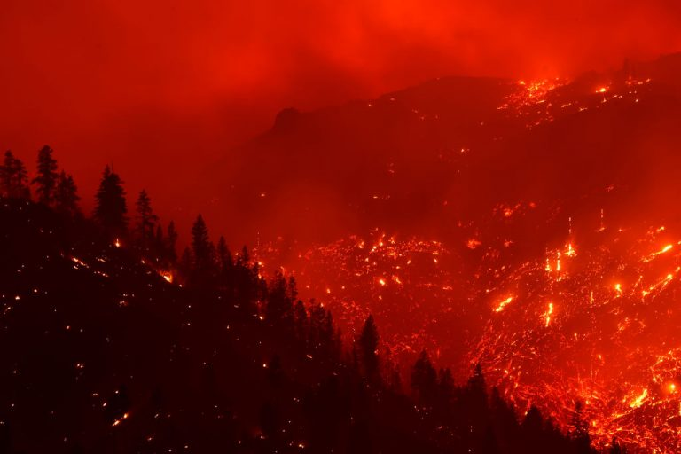 The Dixie Fire burns in the hills on August 17, 2021 near Milford, California. The Dixie Fire has burned over 604,000 acres, has destroyed over 1,000 homes and threatens thousands more.