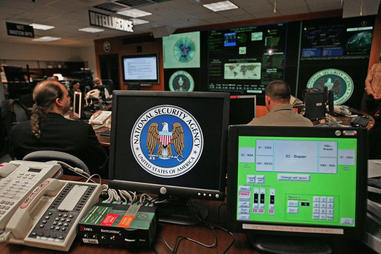 The U.S. Intelligence Community is divided on the origins of COVID-19. A computer workstation bears the National Security Agency (NSA) logo inside the Threat Operations Center inside the Washington suburb of Fort Meade, Maryland, intelligence gathering operation Jan. 25, 2006.