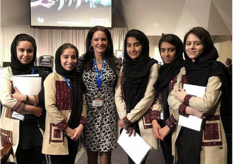 Reneau traveled to Qatar to help rescue 10 Afghan girls who are members of the country's robotics team. In this view from Reneau's Instagram page, she is pictured here when she first met the girls at a summit in 2019.
