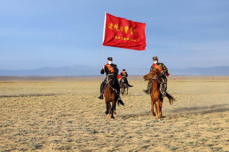xinjiang-china-mounted-police-red-flag