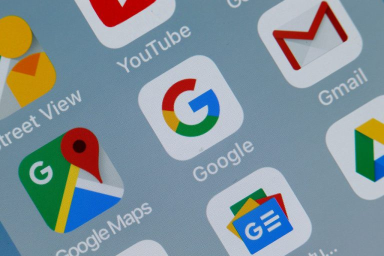 In this photo illustration, the logos of the applications, Google Maps, Google and Gmail are displayed on the screen of a tablet on October 23, 2018 in Paris, France.