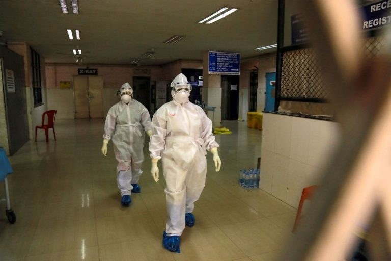 Health officials in full protective gear walk inside an isolation ward of Ernakulam Medical College in Kochi in the Indian southwestern state of Kerala on June 6, 2019. 12-year-old Indian boy Mohammed Hashim died of Nipah virus in a new outbreak earlier this week. The virus causes onset symptoms similar to that of SARS-CoV-2/COVID-19, but leads to encephalitis and mortality rate as high as 70 percent.