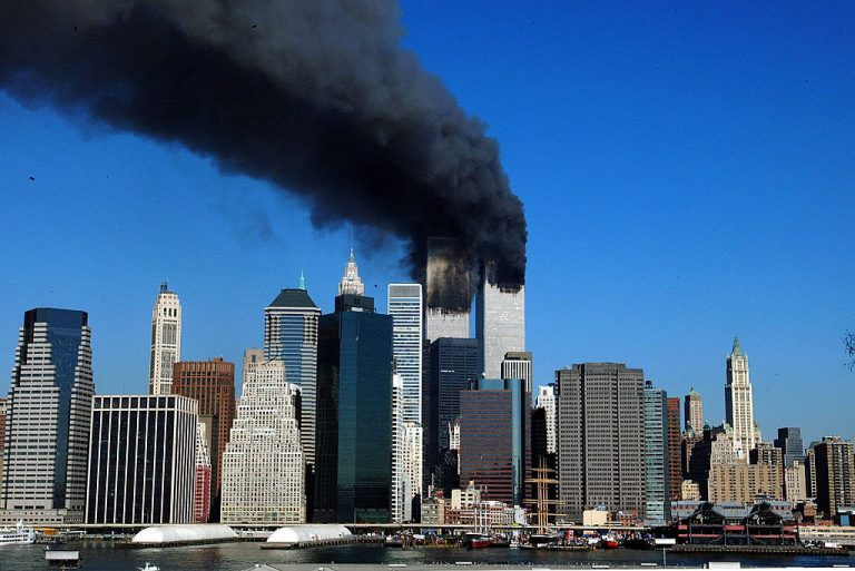The twin towers of the World Trade Center billow smoke after hijacked airliners crashed into them early Sept. 11, 2001.