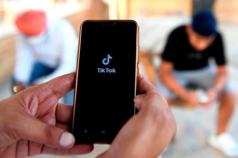 An Indian mobile user browses through the Chinese owned video-sharing TikTok app on a smartphone in Amritsar on June 30, 2020.