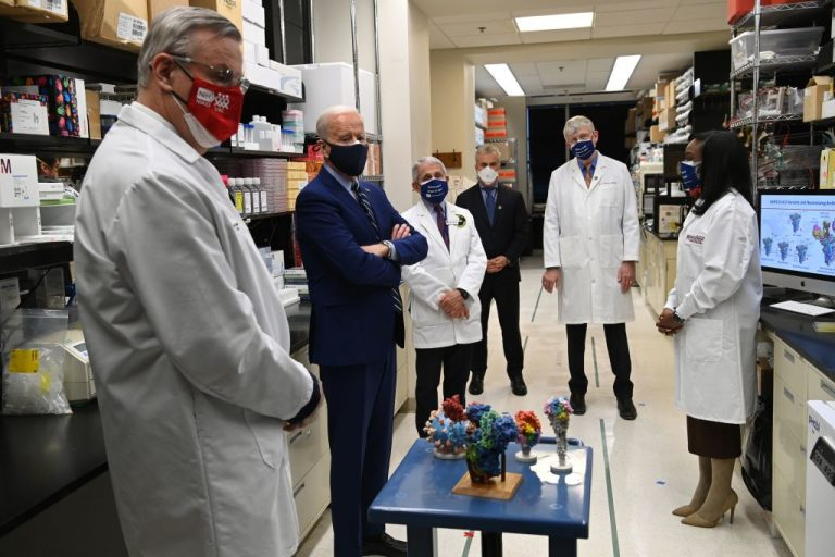 Joe Biden (2nd L) tours the Viral Pathogenesis Laboratory at the National Institutes of Health (NIH) in Bethesda, Maryland, February 11, 2021, flanked by (from R) Kizzmekia S. Corbett, Francis Collins, White House COVID Coordinator Jeffrey Zients, Anthony Fauci and Barney S. Graham. The NIH has funded 265 research papers collaborating with the Chinese Communist Party's People's Liberation Army since 2005.