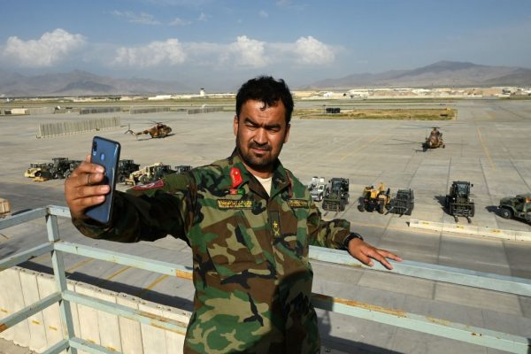 """An Afghan National Army soldier takes a selfie inside the Bagram Airfield after all U.S. and NATO troops withdrew on July 5, 2021. Former President Ashraf Ghani told Joe Biden Afghanistan was under """"full-scale invasion"""" by the Taliban with Pakistani support at the end of July."""