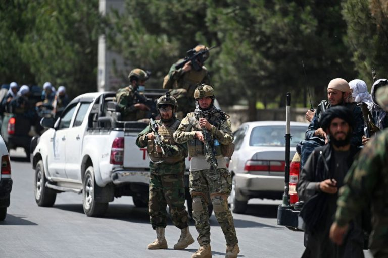 """Taliban Fateh fighters, a """"special forces"""" unit, stand guard on a street in Kabul on August 29, 2021, as suicide bomb threats hung over the final phase of the US military's airlift operation from Kabul, with President Joe Biden warning another attack was highly likely before the evacuations end."""