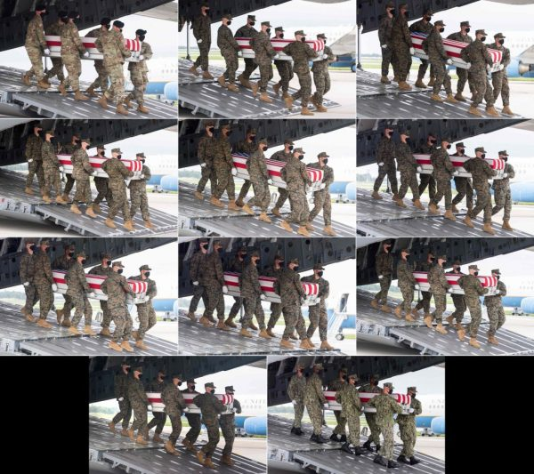 Military transfer teams carry the bodies of 11 of the 13 fallen soldiers who died in the ISIS-K/Taliban suicide bombings at Kabul Airport in Afghanistan on Aug. 26 upon their return to America at Dover Air Force Base in Delaware on Aug, 29, 2021.