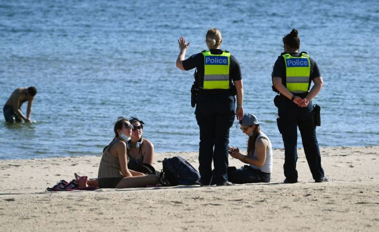 Police intervene in the activities of beachgoers in Melbourne on September 2, 2021, a city whose citizens have suffered more than 200 days of lockdown since the pandemic began. Some worry a social credit score is coming to Australia after a television segment from April promoting a federal parliamentary proposal to require identification to use social media resurfaced.