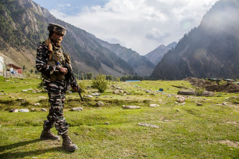 ZOJILA, KASHMIR, INDIA - SEPTEMBER 28, 2021: Indian paramilitary trooper stands guard near the Zojila tunnel construction, which will connect Kashmir with Ladakh in Baltal 100 km east of Srinagar, reducing travel time from 3 hours to about 15 minutes.