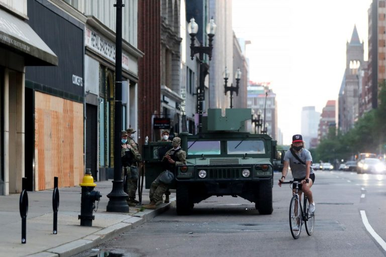 A National Guard tank on Boylston Street, watching over stores that were damaged after a Black Lives Matter protest on June 5, 2020 in Boston, Massachusetts. Governor Charlie Baker deployed 90 members of the state's National Guard to drive school busses amid a staffing shortage.