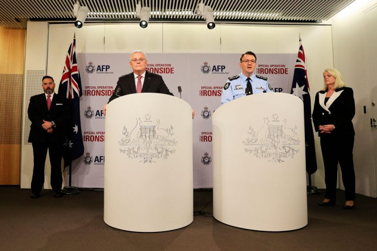 """Prime Minister Scott Morrison and Australian Federal Police (AFP) Commissioner Reece Kershaw speak to the media flanked by FBI Legal Attaché U.S. Embassy Anthony Russo (L) and Minister for Home Affairs Karen Andrews on June 8, 2021 in Sydney, Australia. The Morrison administration passed new legislation on Aug. 25 giving the AFP and the Australian Criminal intelligence Commission sweeping powers to surveil and crackdown against online activity considered an """"offense."""""""