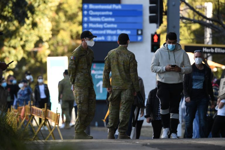 The Australian military monitors the public on August 17, 2021 in Sydney, Australia. The state of South Australia recently deployed a phone app that uses geolocation and facial recognition to enforce 14-day home quarantine.