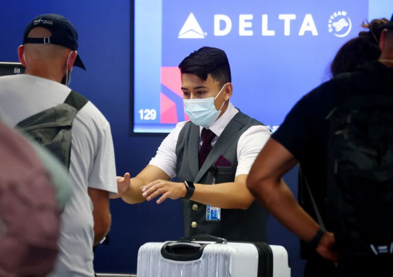 A Delta Air Lines employee works on the departures level at Los Angeles International Airport (LAX) on August 25, 2021. Sen. Diane Feinstein (D-CA) has introduced legislation that will require vaccine passports for domestic and foreign air travel.