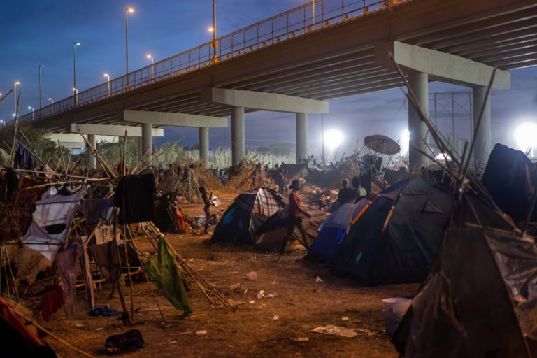 A migrant camp at the U.S.-Mexico border on September 21, 2021 in Del Rio, Texas. Governor Greg Abbott deployed hundreds of State Trooper and National Guard vehicles to secure the border and shrink the migrant camp in place of a border wall