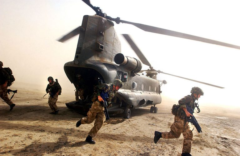 In this file photo of Operation Buzzard from July 8, 2002, British Royal Marines scramble out the back of a Chinook helicopter to conduct a random vehicle search on a dirt path near the Pakistan-Afghanistan border in an effort to deny al Qaeda and Taliban militants freedom of movement in the region. Special forces presence in Afghanistan has been instrumental to keeping militant groups in check.