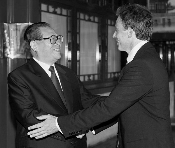 British Prime Minister Tony Blair (R) is greeted by China's disgraced former president Jiang Zemin, at the Zhongnanhai leadership compound in Beijing, July 21, 2003. Blair thinks the world should move in the direction of China's social credit system by installing a mandatory digital identification system.