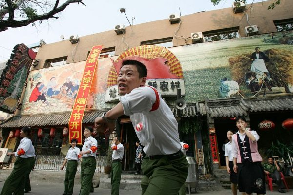 """During a Chinese Communist Party propaganda stunt, attendants dressed as """"Red Guards"""" dance the """"Zhongziwu"""" (loyalty dance) at a Chinese Cultural Revolution-themed restaurant May 30, 2006 in Changchun, Jilin Province, China. Mao Zedong, however, is no hero. Chairman Mao is a mass murderer who installed the philosophy of struggle in his people and led to more than 80 million unnatural deaths."""