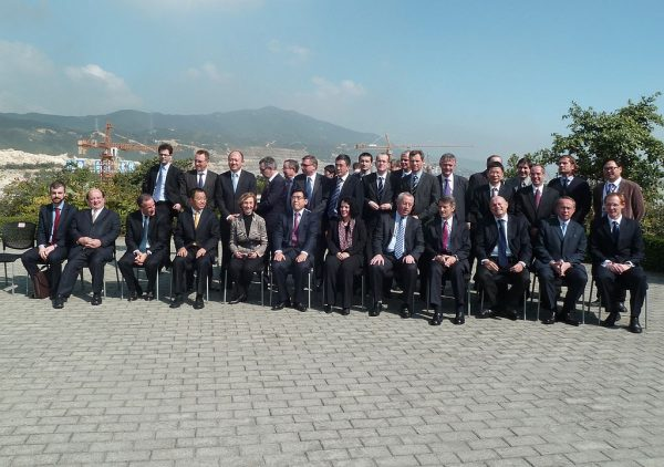 An array of French and Chinese Communist Party officials pose for a picture during a photo op lauding the progress of the Taishan Nuclear Plant in Guangdong on January 22, 2013. As has come to light, the plant was leaking almost double the legal limit of fission gasses as early as May 30.
