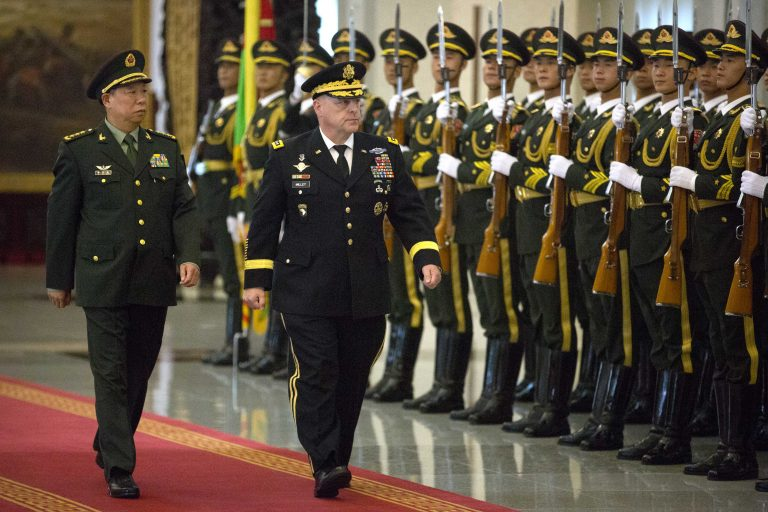 China's People's Liberation Army (PLA) General Li Zuocheng (L) and U.S. Army Chief of Staff General Mark Milley (C) review an honour guard during a welcome ceremony at the Bayi Building in Beijing on August 16, 2016.