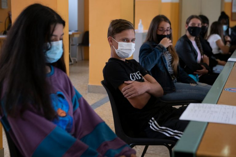 A Colorado school tapes masks to students faces