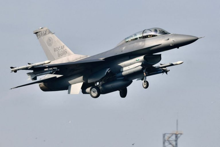 An armed US-made F16 fighter jet takes off from a motorway in Pingtung, southern Taiwan, during the annual Han Kuang drill on September 15, 2021.