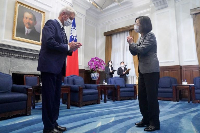 Taiwan President Tsai Ing-wen (R) greets French Senator Alain Richard (L) at the Presidential Office in Taipei on October 7, 2021.