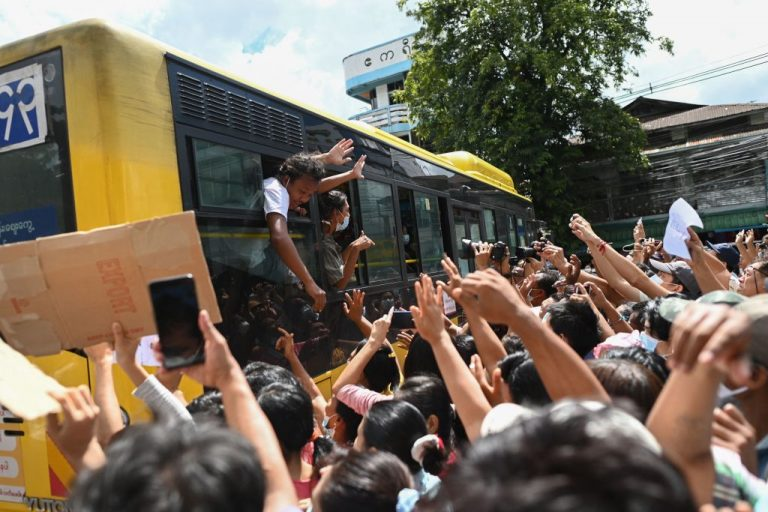 Detainees released from Insein Prison celebrate with the crowd in Yangon on October 19, 2021, as authorities released thousands of people jailed for protesting against a February coup that ousted the civilian government.