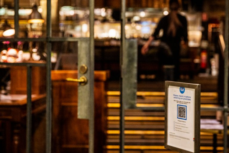A contact tracing QR code is seen at the entrance of a restaurant in Sydney on July 13, 2021. Rashays, a 27-location chain based in Sydney, says it will not reopen its doors when the New South Wales government relaxes restrictions on Oct. 1. Instead, Rashays will wait until Dec. 1 when vaccine passports are scheduled to be scrapped entirely. Co-founder Rami Ykmour said his company expects to lose $10 million during the delay, but feels the sacrifice is worth it for their business values.