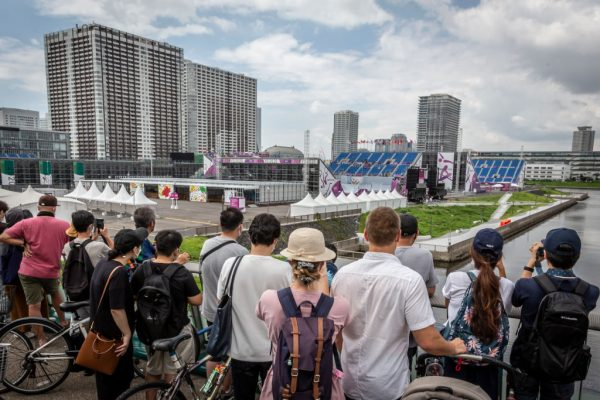 TOKYO, JAPAN - JULY 31: Spectators gather from afar to watch the Men's BMX Freestyle seeding event from a bridge on July 31, 2021, in Tokyo, Japan. Spectators were not allowed to attend the games, which run through August 31.