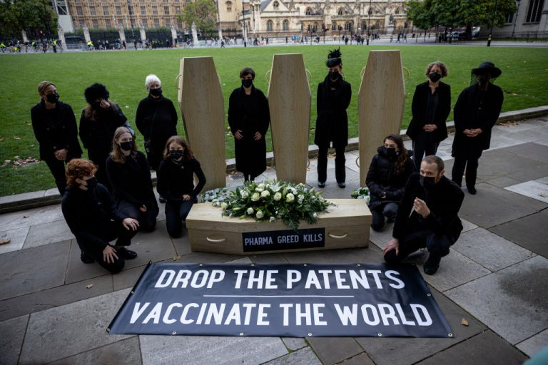 Protesters against vaccine patents pose for a photograph with cardboard coffins in Parliament Square on October 12, 2021 in London, England. A weekly COVID-19 Vaccine Surveillance Report by the UK Health Security Agency examining NHS data showed that while 98 percent of the country had antibodies against SARS-CoV-2 from either vaccination or natural exposure, the majority of cases over 40+ were still vaccine breakthroughs.