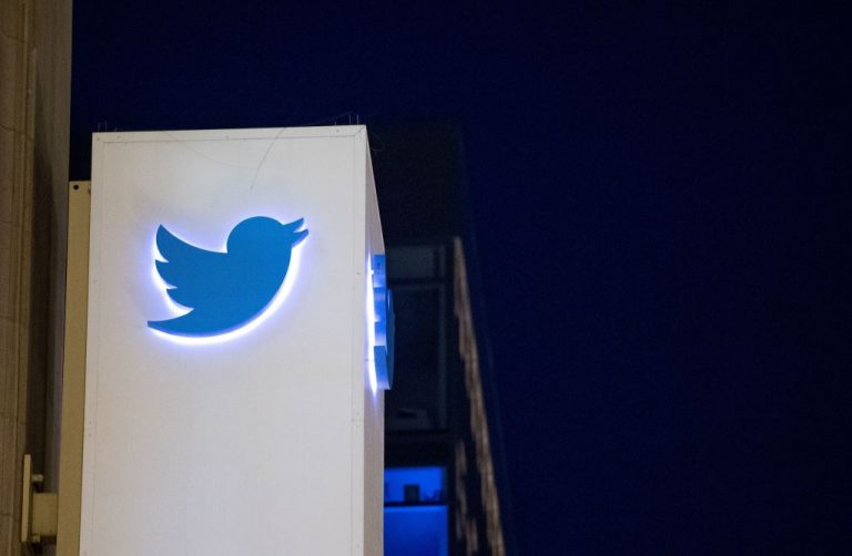 """The Twitter logo is seen on a sign at headquarters in San Francisco on November 4, 2016. Twitter labelled the obituary of 37-year-old Seattle mother Jessica Berg Wilson, whose family says died from """"COVID-19 Vaccine-Induced Thrombotic Thrombocytopenia (VITT)"""" after being required to vaccinate to volunteer at her childrens' school as """"misleading."""""""