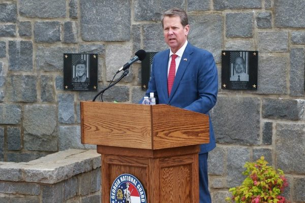 """Brian Kemp, the Governor of Georgia, speaks during a virtual Memorial Day ceremony at Clay National Guard Center in Marietta, Georgia on May 21, 2020. Kemp said he isn't afraid of """"Stacy Abrams and Joe Biden and the left"""" after Coca-Cola CEO James Quincey derided his state's election reform laws."""