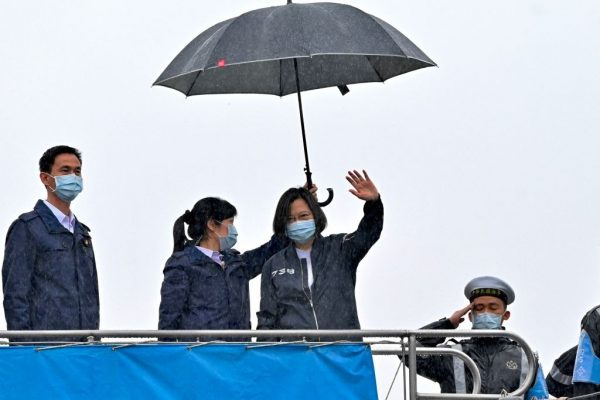 Taiwan President Tsai Ing-wen (C) waves while visiting the ROCS Lan Yang (FFG-935) Frigate during the inspection of a fleet of ships in the Republic of China Navy in Keelung on March 8, 2021.