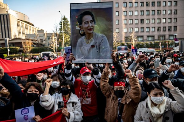 Activists hold a portrait of Myanmar's de facto leader Aung San Suu Kyi during a protest outside the United Nations University building in Tokyo on February 1, 2021, after Myanmar's military seized power in a bloodless coup.
