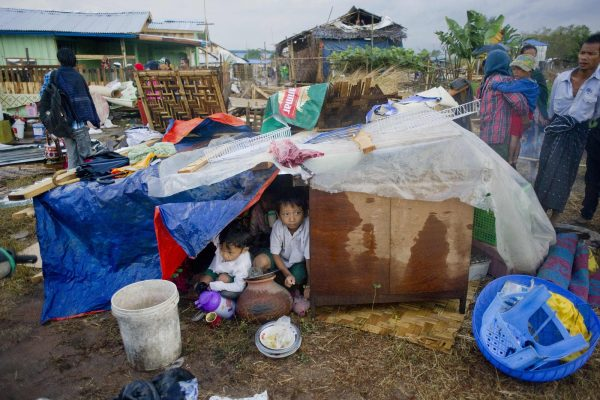 In January 2016, Kirin was already 'in' as the slum area was cleared next to a military-owned beer factory. Residents had been given a one-day notice to leave their homes voluntarily. It is believed, from the photograph above that shows the children's temporary structure crafted in part from a Myanmar Beer advert, that this was a MEHL-owned factory. The children take shelter in a temporary area during the demolition of their homes in a slum on the outskirts of Yangon on Jan. 26, 2016. Hundreds of Myanmar families were left destitute on Jan. 26 after government workers used mechanical diggers to flatten swathes of Yangon slum housing one week before Aung San Suu Kyi's National League for Democracy party came to office. Residents shouted and wept as they scrambled to save their meager possessions as diggers crushed through the bamboo, corrugated iron, and concrete structures.