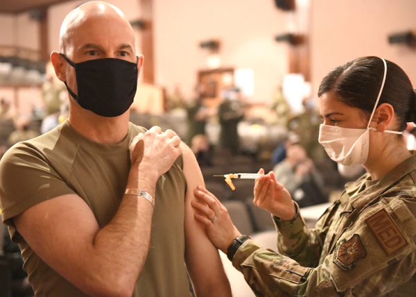 Major General Michael Lutton, 20th Air Force commander, receives the COVID-19 vaccination on Jan. 8, 2020, at the base theater on F.E. Warren Air Force Base, Wyo.