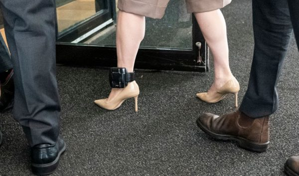 Huawei CFO Meng Wanzhou, while wearing her ankle monitoring device, walks into BC Supreme Court with her security detail to resume her fight against extradition to the United States on September 28, 2020, in Vancouver, Canada.