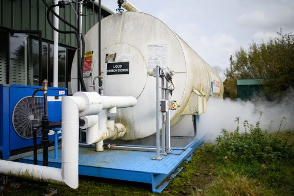 A container of liquid carbon dioxide vents gas during a part of the production process at the Dry Ice Nationwide manufacturing facility on November 11, 2020, in Reading, England. The covid-19 vaccine developed by Pfizer and BioNTech must be kept at ultra-cold temperatures in its journey from the production line to patients.