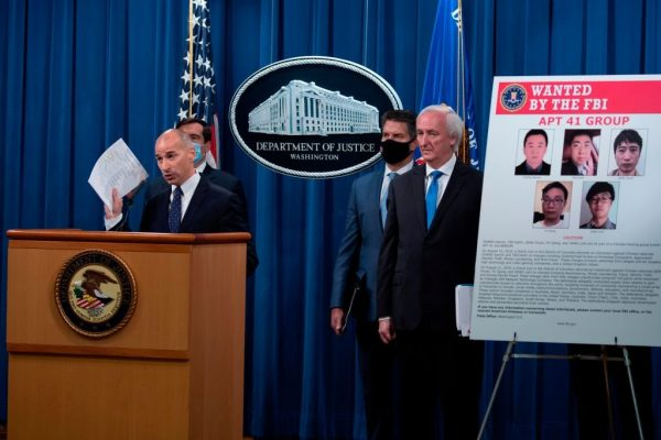"""Acting US Attorney for the District of Columbia Michael R. Sherwin talks about charges and arrests related to a hacking campaign tied to the Chinese government the group called """"APT 41"""" at the Department of Justice in Washington, DC on September 16, 2020."""