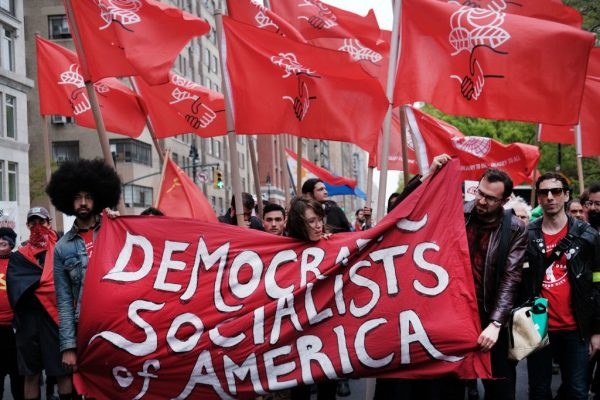 Members of the Democratic Socialists of America gather outside of a Trump-owned building on May Day on May 1, 2019, in New York City. DSA members swept the entire Nevada Democratic Party in a recent Central Committee election.