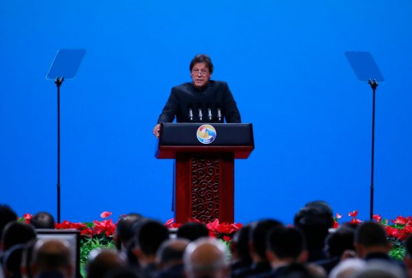 """Pakistani Prime Minister Imran Khan delivers his speech for the opening ceremony of the Belt and Road Forum for International Cooperation (BRF) April 26, 2019 in Beijing, China. Controversy in the Pakistan Senate Chairman election was linked to """"Chinese spy cameras"""" found in the secret ballot booth where Senators were to cast their ballot for the next Chairman."""